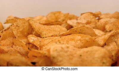 Potato Chips Rotating On Plate - Tasty potato chips rotate...