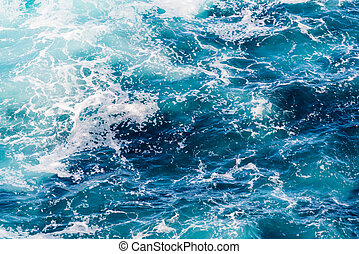 Atlantic ocean with blue water on a sunny day - Waves, foam...