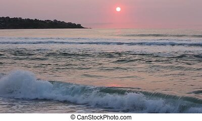 Rising Sun, Pink Sky and Sea Waves. - Big yellow rising sun...