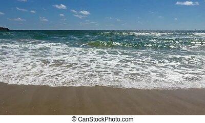 Sea Surf Waves on Morning Beach - Sea surf waves on sandy...
