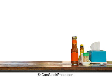 Hot sauce on wood table.