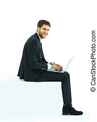 handsome young business - Side view of a handsome young...