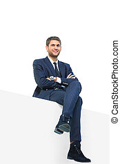 handsome young business man sitting on a white top