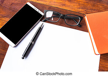 Blank paper with pen and smartphone on wood table concept and Idea for write your text here