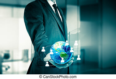 Businessman holding globe in his hands.The concept of...