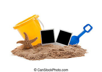 Beach scene with flipflops, sand, bucket and starfish -...