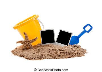 Beach scene with flipflops, sand, bucket and starfish -...