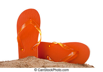 Flipflops in sand on white with copy space - Orange...