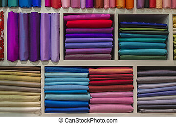 Cloth fabrics at a local market in India. - Cloth fabrics at...