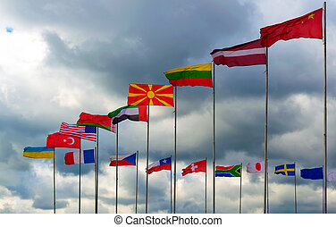 National flags of different country against clouds