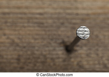 a nail into a wooden plank - close up view of a nail into a...