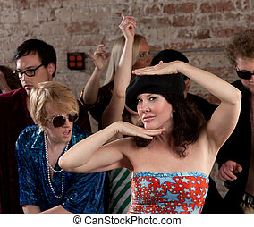 Dancing woman with black hat at a 1970s Disco Music Party