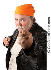 Fat gang member with closed fists and orange bandanna on...