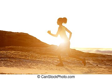 Female runner with sunset