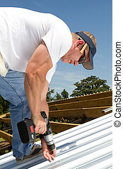 Roofer Fastening Metal Roof - Roofer construction worker...