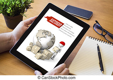 desktop tablet express delivery - hands of a man holding an...