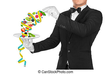 The waiter holding a plate of fruit salad wrapped in measuring tape on an isolated white background. The concept of the diet
