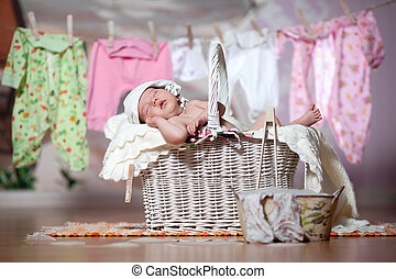 Baby sleeps in a basket after washing