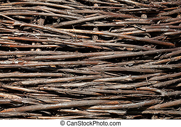Natural brushwood fence, background - A fence made of woven...