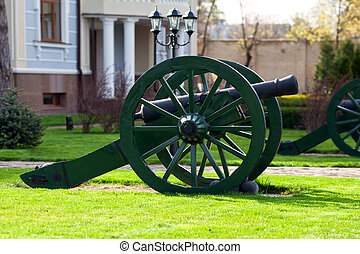 Old cannon with kernels - Old artillery gun with nuclei in...