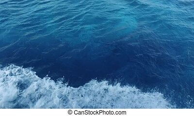 blue sea water with boat trace