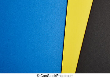 Colored cardboards background in blue yellow black tone Copy...