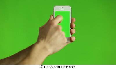 Finger Pointing at Smart Phone with a Green Chroma - A...