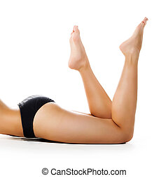 Perfect female legs isolated on white background