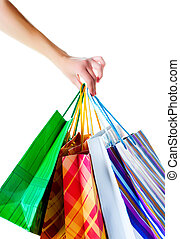 Shopper holding shopping bags. Shot on white background