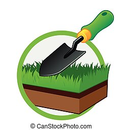 Spade - Small gardening shovel and a piece of grass