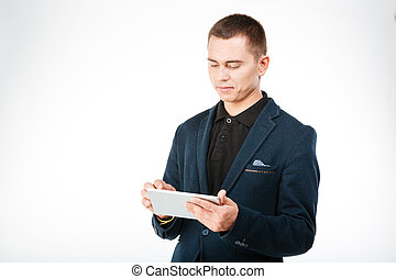 Young businessman using tablet computer isolated on a white...