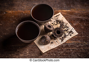 Pressed pu-erh tea - Still life with pressed pu-erh tea and...