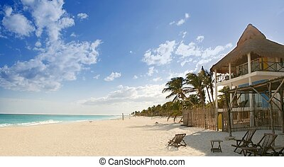 Caribbean sand beach tropical houses in Mexico mayan riviera