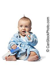 child brushing teeth, isolated on white background