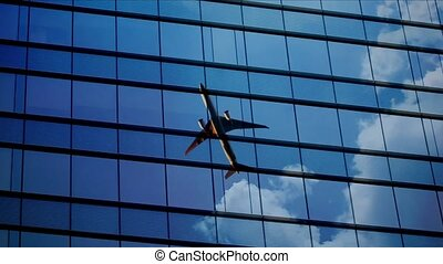 airplane reflect on a window glass with cloud time lapse sky