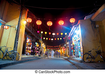 Night view of a street in Hoi An, Vietnam. Hoi An is the...