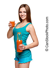 Happy teen girl holding a glass of carrot juice - Dieting,...