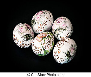 Colorful Easter eggs on the dark background, symbol of...