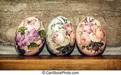 Three Easter eggs stacked on the wooden base, Easter holiday...