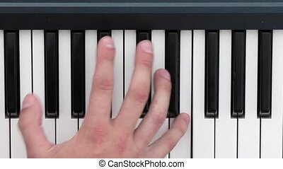 Hands playing music on the piano keyboard - Hands playing...