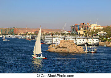 Fellucca in Aswan, Egypt - Boats docked and fellucas sailing...