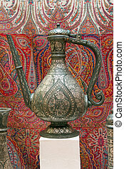 antique jug in eastern style on red background