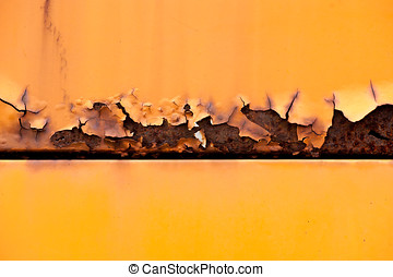 Colorful rusty metal panel with peeling paint from the...