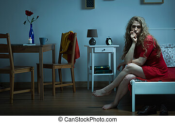 Sad woman sitting on bed - Photo of woman sitting on bed...