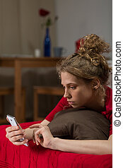 Beautiful blond girl using mobilephone - Image of beautiful...