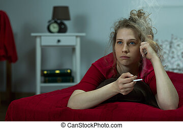 Depressed young girl with cigarette - Image of depressed...