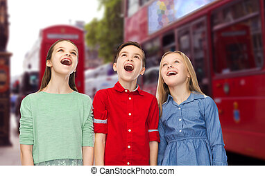 amazed boy and girls looking up over london city