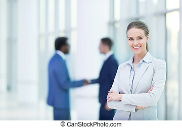 Overtime - Smiling businesswoman in office