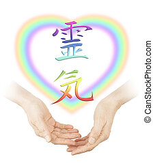 Sharing Reiki healing - Female cupped hands with a soft...