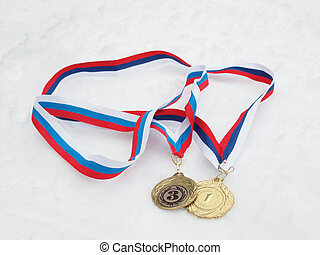 Medals on a snow - Gold and bronze medals on a snow